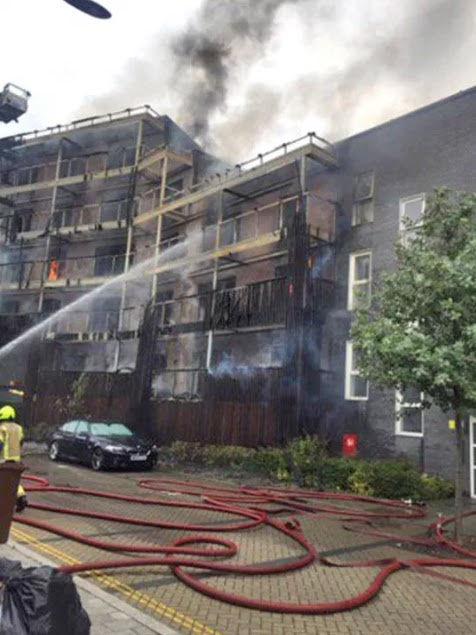 Fire rips through newly built block of flats in east London