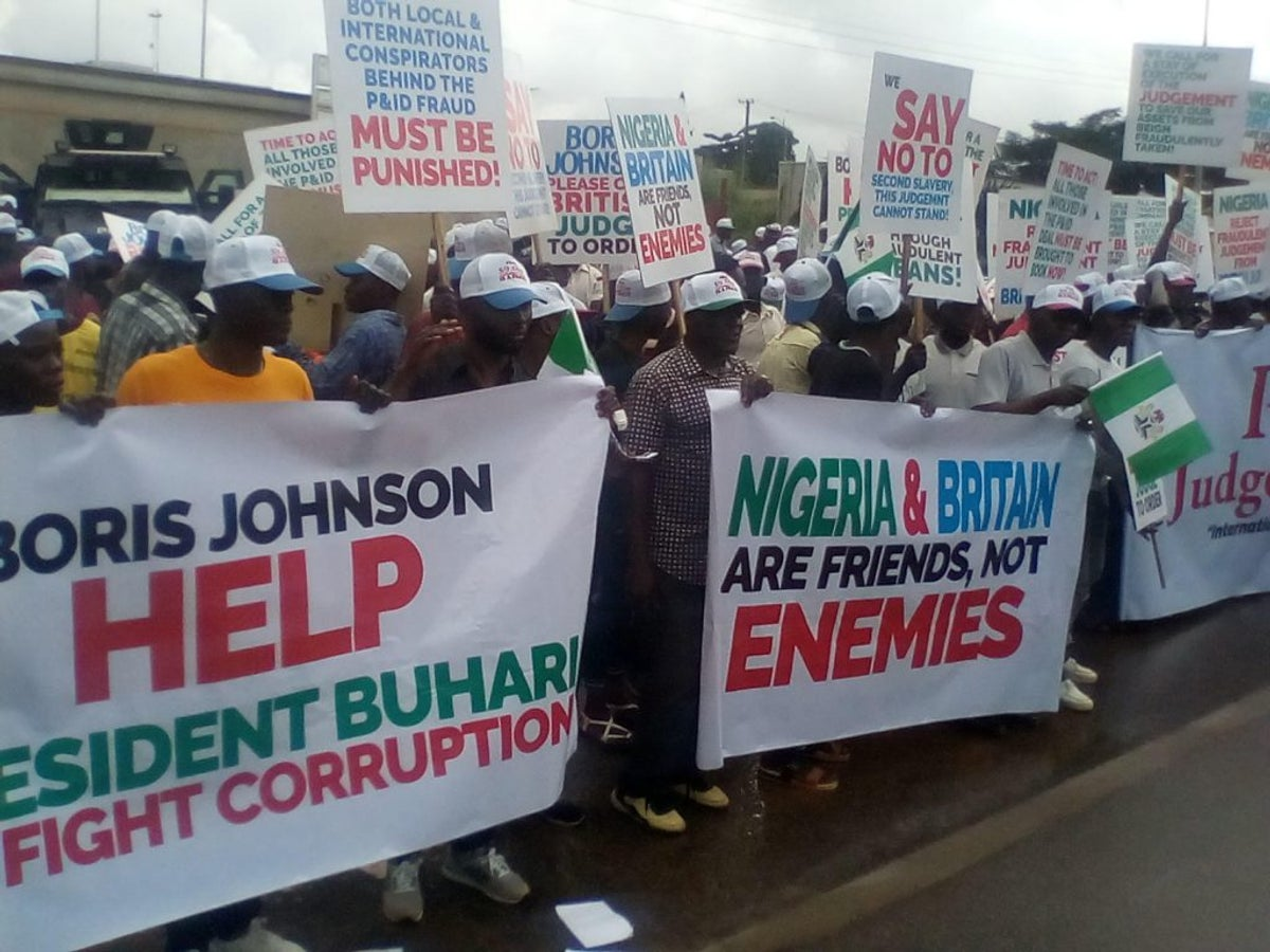 JUST IN: Group Storms UK Embassy, Protest $9.6bn Judgement(photos)