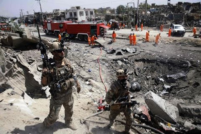 After Taliban Bomb Kills Civilians, Afghans Call For Foreign Compound To Be Closed
