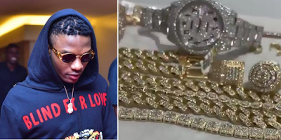 wizkid flaunts his collection of diamond wristwatch and necklaces video