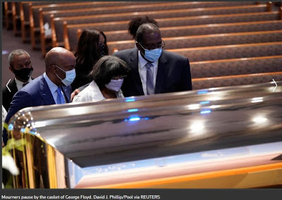SAD PHOTOS: George Floyd Buried Beside His Mother In Houston