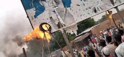 PHOTOS: Angry Protesters Burn Buhari's Billboard In Katsina