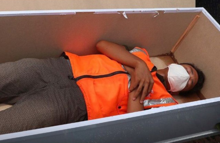 Police In Indonesia Made People To Lie In Coffins For Not Wearing Face Mask