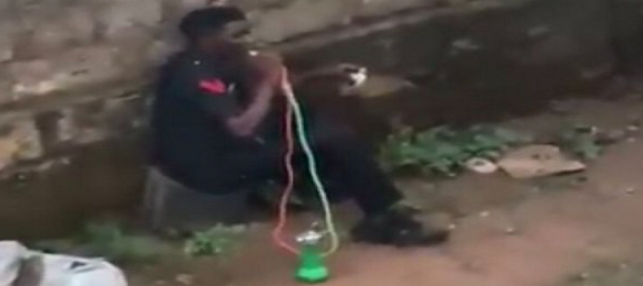 Nigerian Police Officer Caught On Camera Smoking Shisha